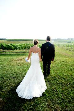 Bride and Groom walking in Vineyard